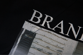 Black shirt with print of text brand