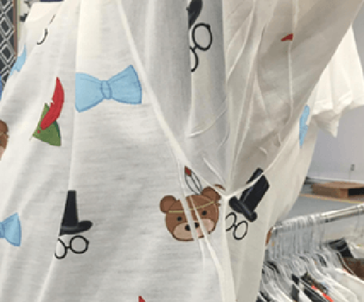 White shirt with cute designs and white streaks in the armpit