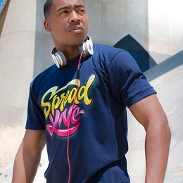 A man wearing a blue printed spread love t-shirt with headphone hang on his neck