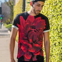 A man wearing a red flower printed on the black t-shirt