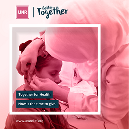 UMR together for health campaign with a woman checking the ear of the girl
