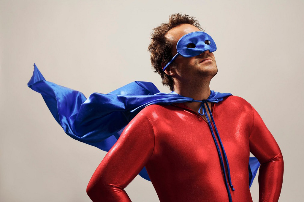 Funny portrait of man being a superhero