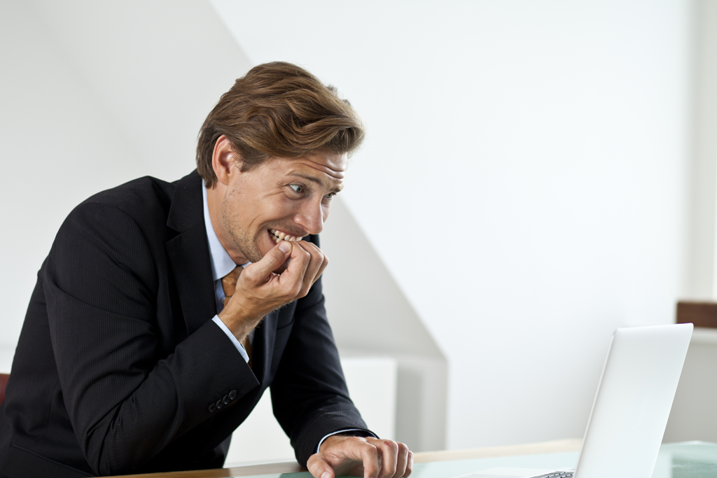 Businessman is panicking while looking at the laptop