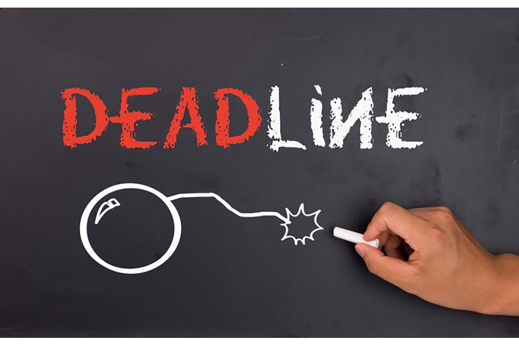 Word deadline and a bomb written with a chalk on blackboard