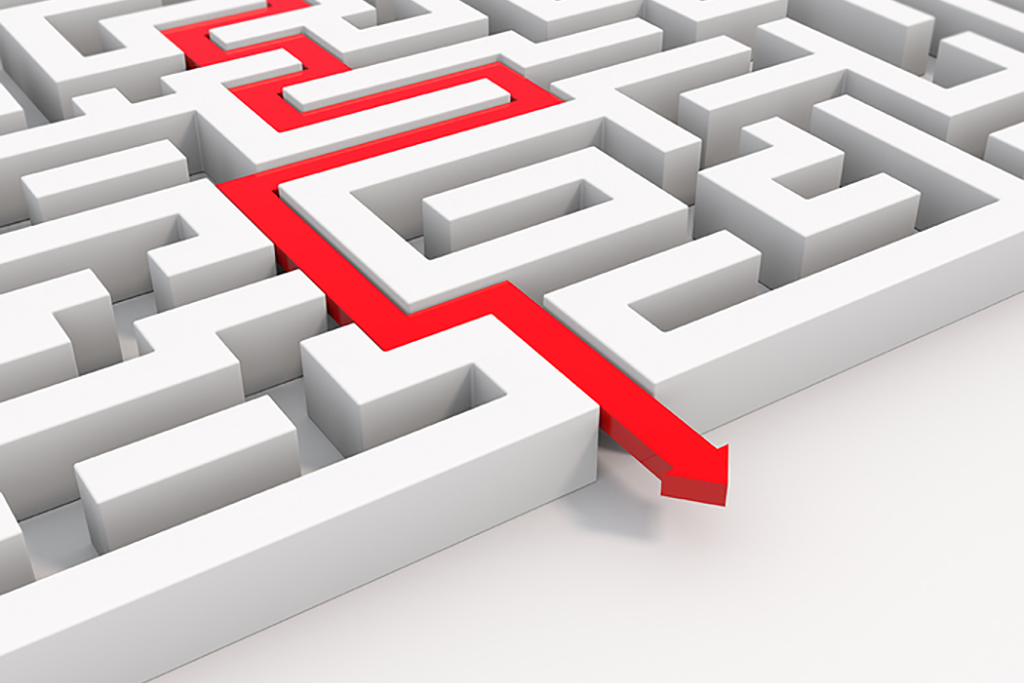 A 3D red arrow leading through a maze