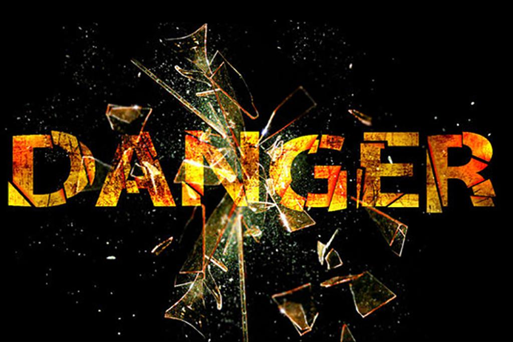 Broken lettering of the word danger with broken glass