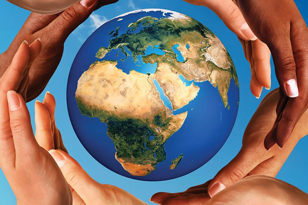 Beautiful conceptual symbol of the Earth globe with multiracial human hands around it