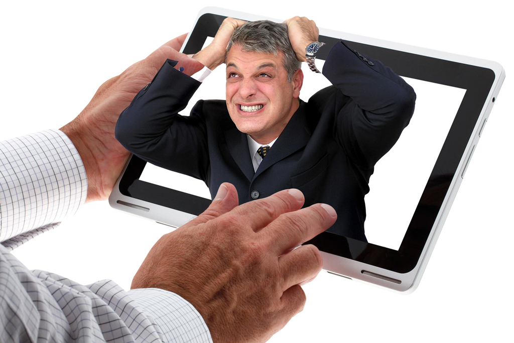 Businessman holding a tablet with a frustrated man displayed