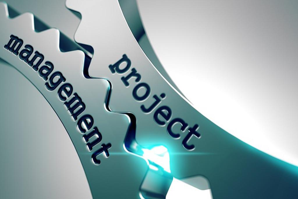 Project management concept on the mechanism of metal cogwheels