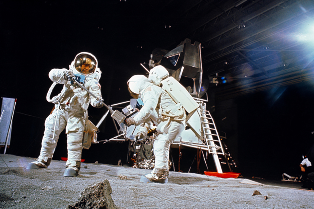 Astronauts in outer space landing on moon