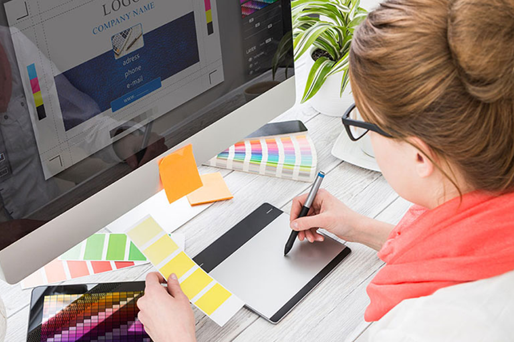 Graphic designer at work with color swatch samples