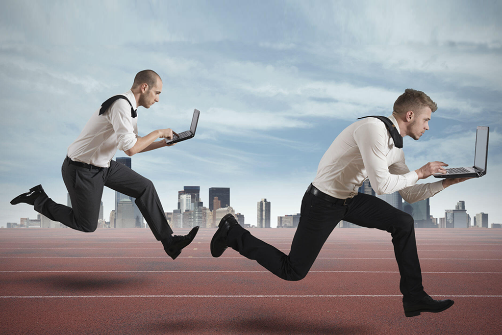Competition with two running businessman holding laptop in a track