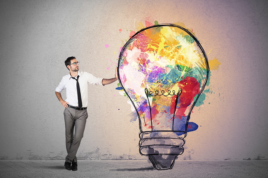 Concept of creative business idea with colorful lightbulb