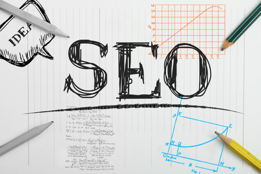 SEO concept written on a paper with four pencil pointing on it