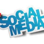 A paper cut with social media words in it and a pin