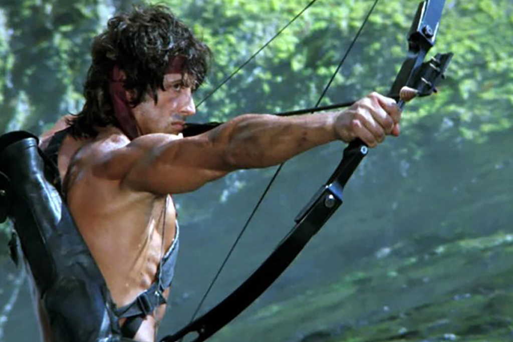 Curly middle hair archer with a long bow in forest