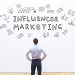 A man facing back while looking up a social media icons surrounding the words 'Influencer marketing' tagline