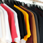 An array of hanger shirts in a hanger rod stand