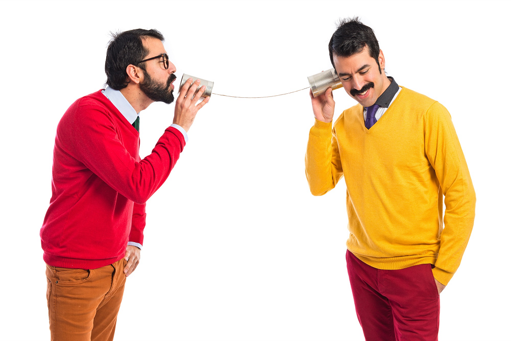 Two man talking using a string can phone
